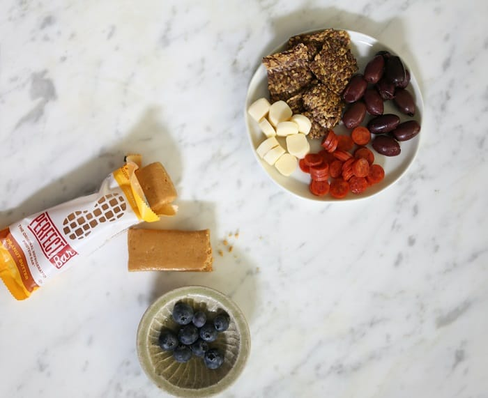 Perfect bar on a marble surface with fruit, cheese, and olives